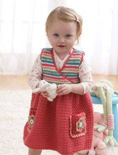 This girl's jumper dress is available in 3 different sizes which include 18 months, 2 years and 4 years of age. It is made with Bernat Softee Baby Yarn.