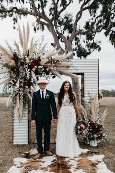 Wedding Designs iron wedding arch with plumes of pampas grass and burgundy flowers - With grand entrances on helicopters and horses, this Townsville cattle station wedding was luxe meets country, captured by SB Creative Co. Chic Wedding, Wedding Trends, Wedding Designs, Fall Wedding, Rustic Wedding, Dream Wedding, Elegant Wedding, Burgundy Wedding, Wedding Ceremony Ideas