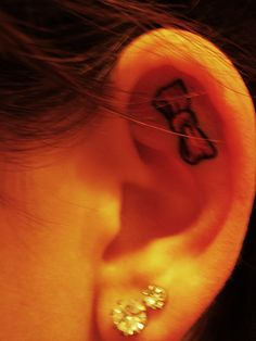 Bow tattoo, ear. Really cute, but I'm sure it'd hurt like a bitch. I've got a good pain tolerance, but I don't think I could ever do this! Lol.