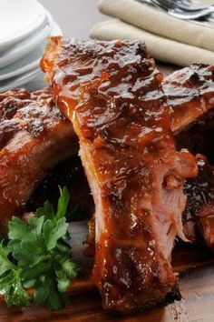 Slow Cooker Baby Back Ribs ~ Serve these tantalizing goodnesses with any veggies, mashed potatoes or just along with hot sauce and they will be a sure crowd pleaser.