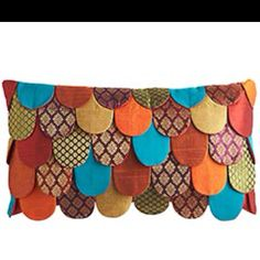 Overlapping petal pillow from Pier1... saving all kinds of sweaters and old clothes to repurpose into colorful throw pillows!