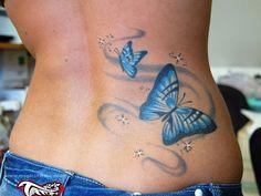 Butterfly lower back tattoo