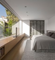 Beautiful bedroom, sunlight, TV, large surface, Carpeted and wooden flooring, modern, simple colour scheme.
