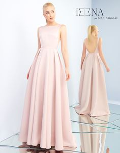 Satin, A-line evening gown showcasing a bateau neckline and illusion cut outs on the side of the bodice.