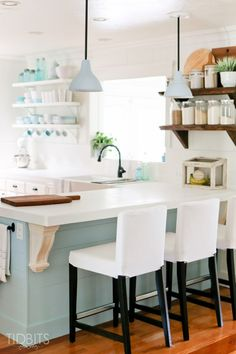 Cottage kitchen with lots of character from rustic wood shelves and planked walls eclecticallyvintage.com
