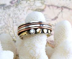 Spin Ring with Sterling Silver, Copper, Gold & Diamond. $250.00, via Etsy.