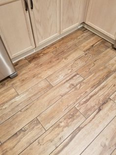 Is it wood or is it tile? Its tile. I love the wood plank tiles they look and feel so real. Wood Plank Tile, Wood Planks, Tiles For Less, Hardwood Floors, Flooring, Porcelain Tile, Tile Floor, Rustic, Paint