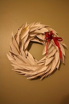 Recycled Book Wreath Tutorial. I love the shape of the petals/leaves in this version