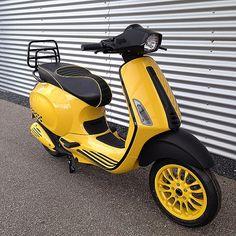 Bright yellow Vespa