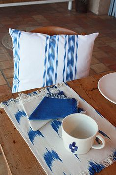 #blue #ikat #cushion #tablemate #pottery handmade in Mallorca By Teixits Vicens