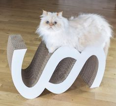 Here's a beautiful handcrafted cat scratcher and lounge from Germany. The intriguing shape and crisp white finish make it look like modern art, but kitty will love to scratch and play on it. The curved surfaces andlittle hideaway compartments are definitely catfriendly! Plus, you can flip it over and use either side, for extended wear.…