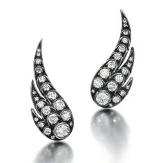 These Wings of Desire earrings by Jessica McCormack contain brilliant-cut diamonds set into 18 carat blackened white gold. Discover our top 5 earrings and ear climbers for a fine jewellery and fashion forward gift for women: http://www.thejewelleryeditor.com/jewellery/top-5/top-5-on-trend-earrings-christmas-gift-ideas/ #jewelry