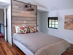 Use pieces of reclaimed wood with similar lengths and widths to create a one-of-a-kind headboard. Frame the planks to give the headboard a finished look. Complete the headboard with a light varnish or sealant to protect it and to avoid getting splinters.   - CountryLiving.com