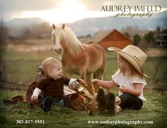 Lulu the horse photobombing in a cute way for this 12 month portrait session with big sister