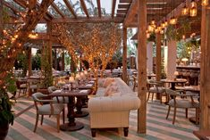 Cecconi's outdoor restaurant decorated like a private garden features a retractable roof to protect guests from rain.