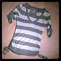 Guess Top Light and charcoal grey striped top.  Button accent on sleeves and side ruching and ties Guess Tops