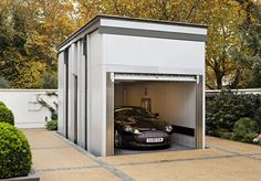 KSR Architects | Two Houses | Car lift : Classic style garage/shed by KSR Architects