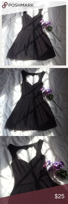 Topshop Dress!!!! Beautiful little black dress by Topshop. Heart cutout back and cutout sides. 92% acrylic 7% polyester. Inner polyester lining. Gently worn but in good condition. Comes from a smoke-free pet-free home. Fast shipping! NO TRADES! Topshop Dresses Mini