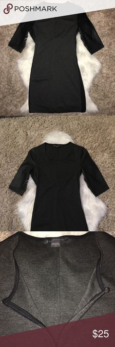 Armani Exchange Charcoal Gray Body Con Mini Dress Armani Exchange Charcoal Gray Body Con Mini Zipper Dress.  Color block with black Vegan leather 1/2 sleeves, black Vegan leather tuxedo stripes on both sides that un/zip from armpit down to hem, wear zipped down or zipped up to create sexy slits. Crew neck with hidden zipper down front/center to convert into v-neck (and show some cleavage!) Doesn't pass the finger tip test (5'7), prices to sell. Wore once, no signs of wear! Priced to sell ;-)…