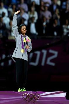 Gabrielle Douglas of the United States celebrates after winning the gold medal in the Artistic Gymnastics Women's Individual All-Around final.