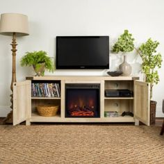 Give your living space a charming country feel with this cozy fireplace TV stand from Winmoor Home. With a concealed storage space, adjustable shelving, and a beautiful electric fireplace insert, this TV stand is the perfect addition to every living room. Fireplace Tv Stand, Cozy Fireplace, Barn Door Tv Stand, Barn Doors, Tv Stand With Storage, Farmhouse Fireplace, Modern Farmhouse Style, Rustic Farmhouse, Space Furniture