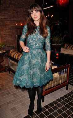Going Green from Zooey Deschanel's Best Looks In celebration of her February 2013 Glamourcover, the actress attended the magazine's dinner party in Los Angeles wearing a lacy Monique Lhuillier A-line dress. She paired her ladylike frock with black tights and matching pumps.