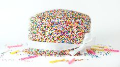 This easy tutorial will show you how to cover a cake with sprinkles.