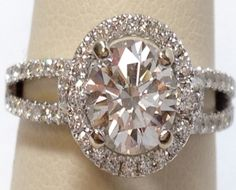 18kw   1.71ctw  VS2/E Diamond Halo ring size 6 1/2