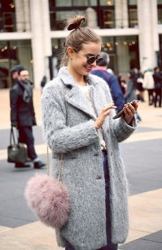 Fuzzy coat and playful pink cross body bag