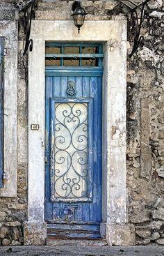 Blue door in old wall