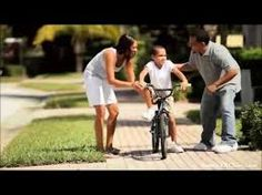 Cute young African american boy being encouraged by his parents as he practices his Best Chiropractor, Chiropractic, Acupuncture, Stock Footage, Clinic, Parents, African, Teaching, Bicycle