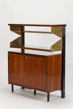 Anonymous; Mahogany, Enameled Aluminum and Brass Cabinet by FEAL, 1950s.