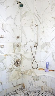 When adding a seat to your walk-in shower, position it within arm's reach of shower controls and handheld sprays so you can manage showering systems while sitting. #showerremodel #showerbenchideas #bathroomideas #walkinshower #bhg Shower Seat, Shower Floor, Walk In Shower, Open Bathroom, Master Bathroom, Glass Shower Doors, Shower Remodel, Beautiful Bathrooms, Bathroom Designs