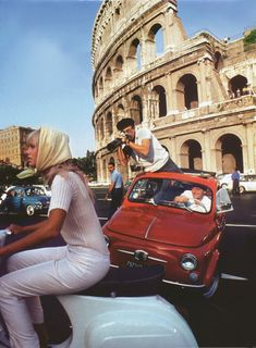 Peter Sellers taking a picture of his wife, Britt Ekland in Rome, 1960s.