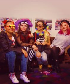 Everyones dressed up crazy then Perrie's over there bein' cool and calm like 'im not with them'lol