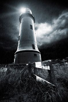 Dark lighthouse. I wouldn't want to be up there by myself! ( it's abandoned and no visitors are allowed...)
