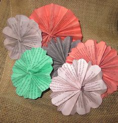 #Vintage Book Page Paper Flower Fan Rosettes from RedbirdCountryDecor. The perfect centerpiece or decoration to your next party!