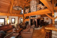 Rustic Living Room with a 3-sided Fireplace! Barn Home Living with open floor plan! Sand Creek Post  Beam  https://www.facebook.com/SandCreekPostandBeam?focus_composer=trueref_type=bookmark