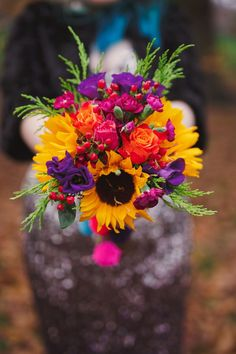 Beautiful sunflowers mixed with a variety of bright and bold colors to complement any sSummer wedding.