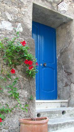blue doors in positano