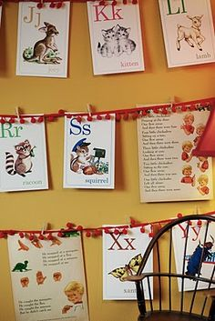 Banner made from alphabet cards clipped to tiny pom-pom trim - also love high shelving display in this nursery