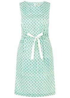 Hand printed green dress with abstract print in 100% cotton. Sleeveless with elasticated waist and ribbon detail. Length 101cm.