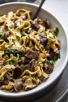 This Instant Pot Beef Stroganoff recipe results in the most tender beef, in a saucy, creamy gravy. The egg noodles even cook in your pressure cooker. #beeffoodrecipes