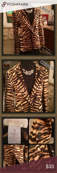 NWOT Chico's Tiger Print Blazer Faux Leather Trim Gorgeous Tiger Stripe Print Blazer from Chico's!! NWOT! Faux leather piping on collar & pockets. Back has a slit on the bottom. Button closure. 4 buttons on sleeves. Great detailing! ❤️ Chico's size 1, which is a Medium, size 8/10, I wear a 12 & it fits me but tight on arms so I would think it would fit a size 10 the very best! Fully lined! 98% Cotton 2% Spandex. Lining is 100% polyester. Some pics show sleeves rolled up. Don't miss this…
