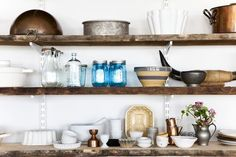 Reclaimed shelving. Remodelista. Combined with modern kitchen.