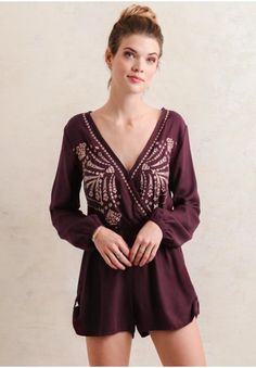 Gorgeous plum hue romper with intricate embroidered detailing. Make an entrance in this must-have piece.