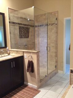 Newly remodeled stand up shower with beautiful tile work.