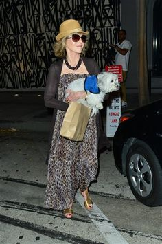 Jane Fonda carried her dog to the car following dinner at Craig's restaurant in Los Angeles on Aug. 2, 2015.
