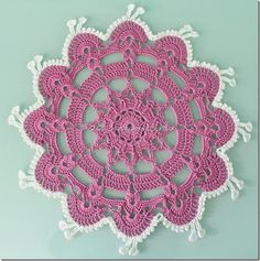 Dancing doily, original pattern can be found here : http://www.free-crochet.com/detail.html?code=FC01086_id=311