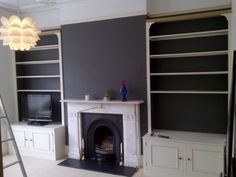 Feature wall lounge with dark paint